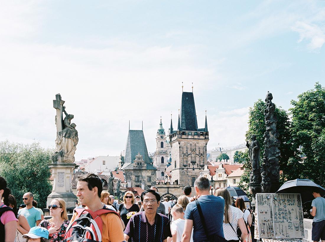 People on the Carlsbridge in Prague