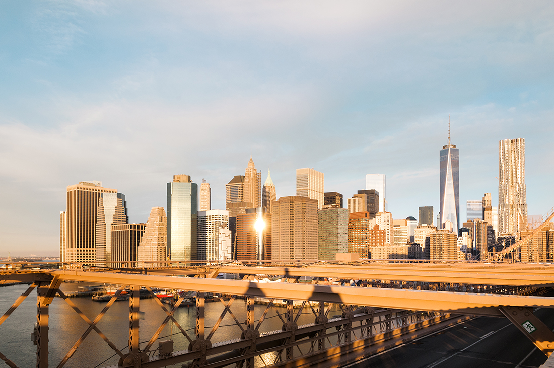 brooklyn bridge and financial district in new york city at sunrise