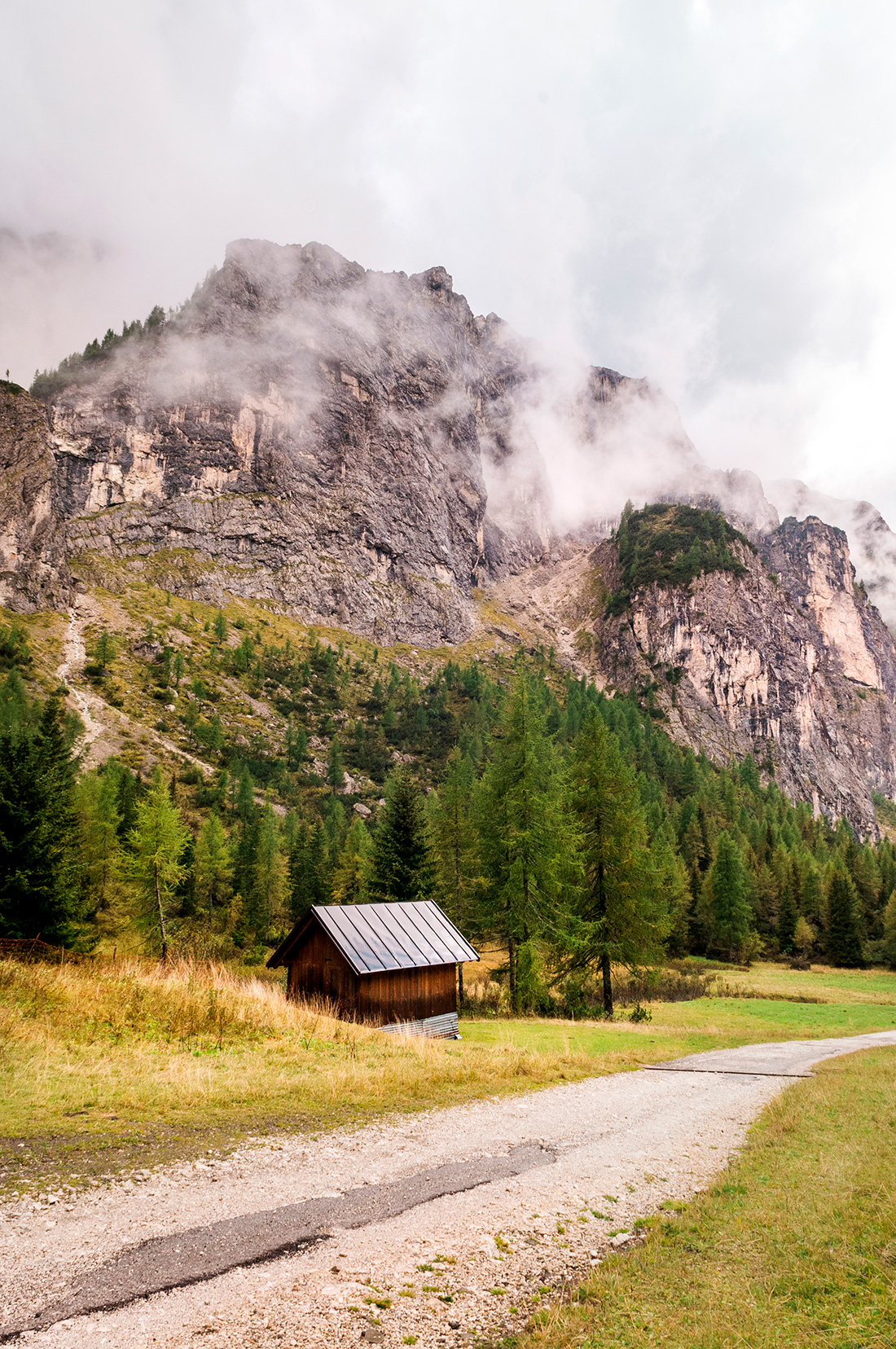 Small cottage against a mountain range
